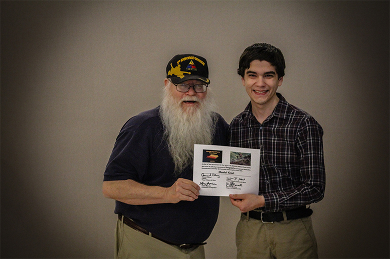 Jim Hollingsworth (left) promoting Daniel Guel (right) to Sergeant in the Texas Chess Militia.