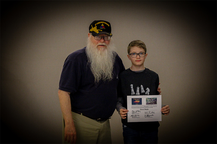 Jim Hollingsworth (left) promoting Drew Shafer (right) to Sergeant in the Texas Chess Militia.