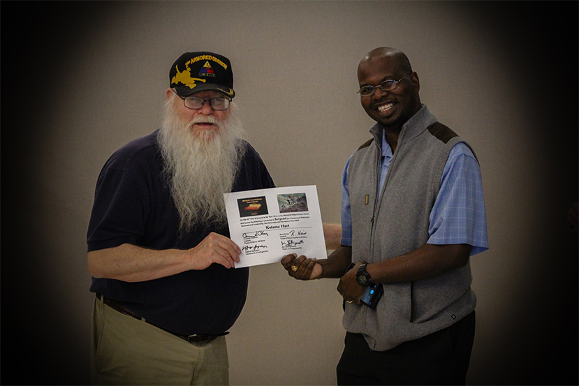 Jim Hollingsworth (left) promoting Kwame Hart (right) to Sergeant in the Texas Chess Militia.