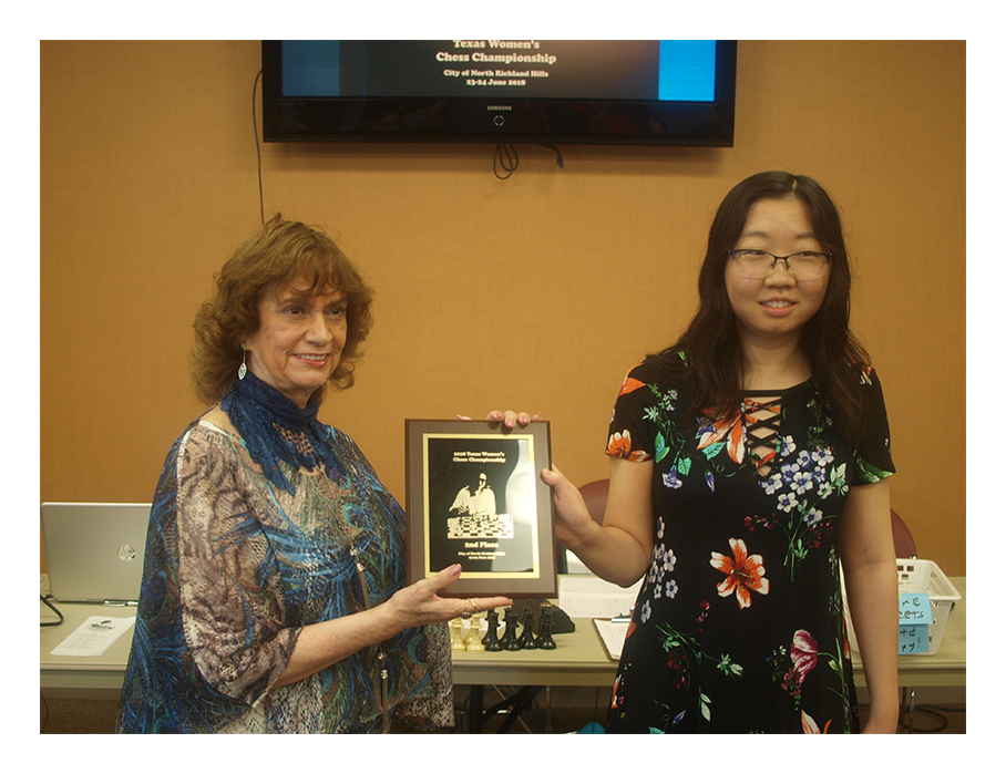 Marrita Del Rio Sumner presenting 2nd Place award to Yue Chu